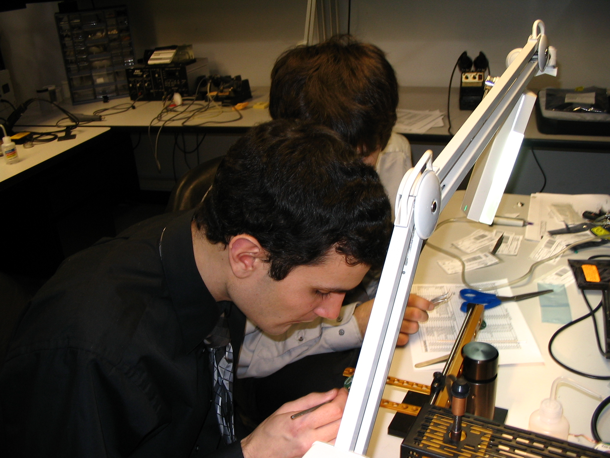 Benoit and Ryan populating boards in the SMT Lab