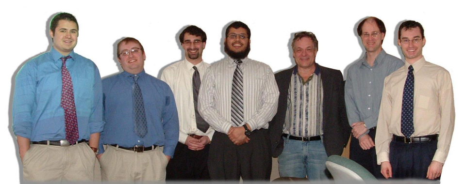 From left to right: Scott Rioux, Greg Pawlowski, John Scipione, Sarmad Abedin, Chuck Moon, Perry Voyer, Anthony Berwin