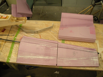 Wing tip sections being test fitted together.