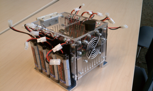 Current version (February 2012) of a portable & sustainable charging system for battery packs.