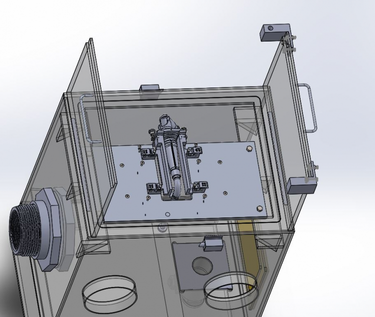 This shows a top view of the chamber. Inside you can see where the nozzle will be placed in the new test block. In addition, you can also see the solenoid that is attached to the door on the right that will serve as part of the locking mechanism.
