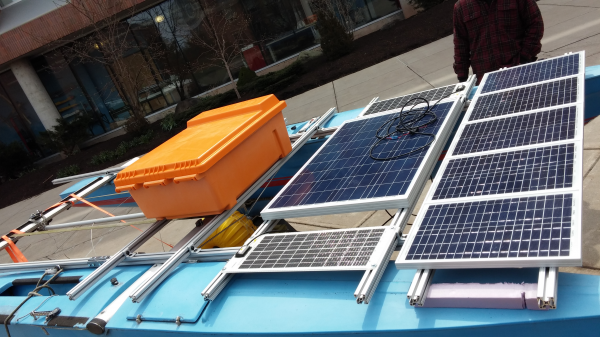 This picture shows both solar panel arrays and the electrical box mounted to the full-scale boat.