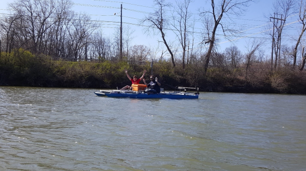 Matt H. and Max test the boat in the Genesee River. The boat was able to successfully move under the power of the two motors with the river current as well as with the weight of its two riders.