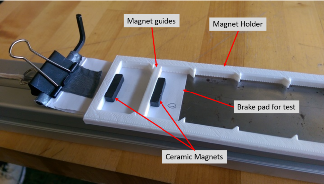 Two ceramic magnets held by 3D printed spacer