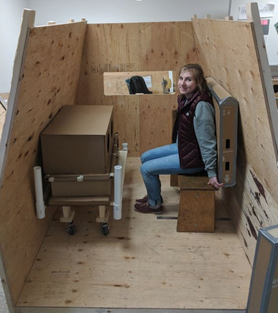 Image 1: Alexa Boyd (Interior Design) testing the location of the seating with a bench.