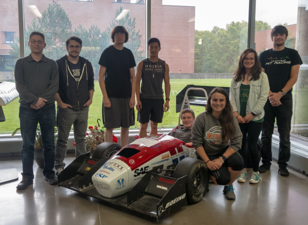 Team in front of RIT Racing's F20 Racecar: From left, Bryan Lilly, Michael Crenella, Yuri Yakovlev, Lucas Wong, Derek Schomer, Paige Byers, Sarah Wilkes, Alexander Bowman